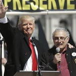 Donald Trump, left, and Carl Paladino, who ran for governor of New York as a Republican in 2010, speak during a gun rights rally at the Empire State Plaza on April 1, 2014.  AP / Mike Groll
