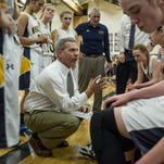 Port Huron Northern coach Mark Dickinson talks with players in a huddle during a state quarterfinal basketball game Tuesday, March 15, 2016 at Fenton High School.