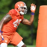 Clemson's Chris Register goes through drills during the Tigers' fall camp.