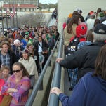 Massive crowds await their turn to enter the Pensacola Bay Center on the second day of Pensacon 2015. The convention has outgrown the Bay Center's facilities, which are not equipped for conventions and trade shows, displaying the need for a convention center in Pensacola.
