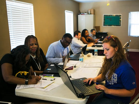 Attorney Melanier Yelder of Yelder Law Firm, Lexie Gordon, a volunteer from Temple of Praise, and Josie Holland, a public interest counselor for The University of Memphis Law School, work during a record expungement clinic at Bloomfield Full Gospel Baptist Church on Saturday, July 29, 2017.