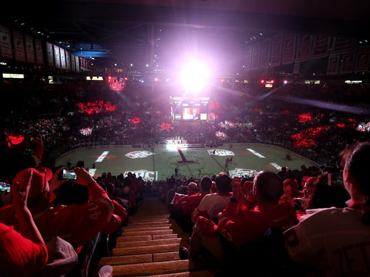 Red Wings fans react during pregame ceremonies before