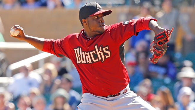 Arizona Diamondbacks pitcher Rubby De La Rosa throws against the Colorado Rockies during the second inning on Wednesday, March 4, 2015, at Salt River Fields at Talking Stick.