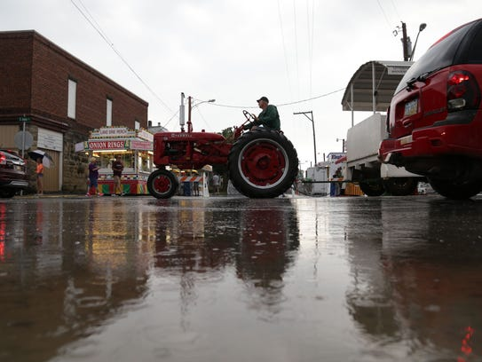 People braved the rains on Friday for the 50th annual