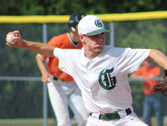 Senior Tyler Newitt hurls a pitch for Groves in the