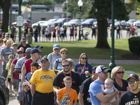Fans lined up around the perimeter of Kellogg Park to meet Pittsburgh Penguins forward Kevin Porter.