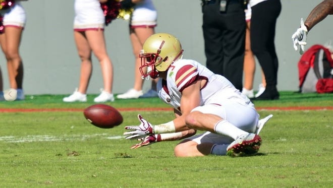 Boston College sophomore Michael Walker, a Naples graduate, attempts to catch a pass Saturday against North Carolina State. He finished with six grabs for 78 yards.