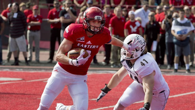 Eastern Washington's Cooper Kupp runs past Montana State's Grant Collins after a reception during the first half of an NCAA college football game, Saturday, Sept. 19, 2015, in Cheney, Wash.