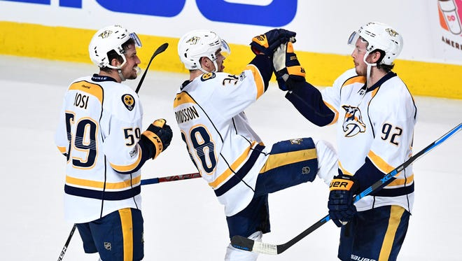 Nashville Predators defenseman Roman Josi (59), left wing Viktor Arvidsson (38) and center Ryan Johansen (92) celebrate after the win in Game 1  in the first-round NHL playoff series at the United Center, Thursday, April 13, 2017, in Chicago, Ill.