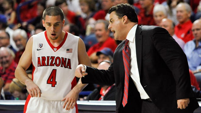Arizona Wildcats head coach Sean Miller talks to guard T.J. McConnell (4) on the sideline during the second half against the Mount St. Mary's Mountaineers at McKale Center. Arizona won 78-55.
