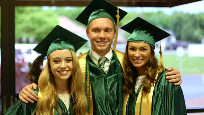 Graduates Redeemer Classical Academy include, from left, From left to right, Cayln Jones, Eric Hein and Allie Wyatt.