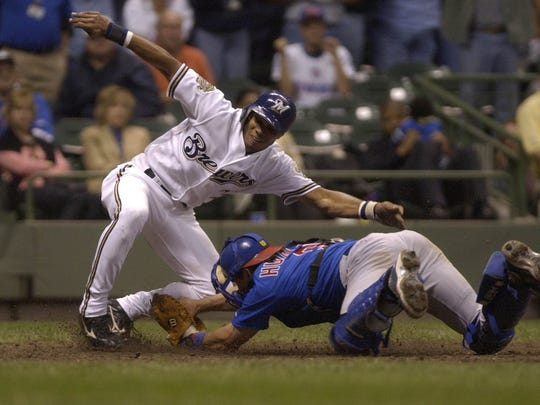 Brewers Alex Sanchez is tagged out at home by Cubs catcher Todd Hundley in the bottom of the 9th. The Brewer would have won the game 6-5 had he been safe. The Milwaukee Brewers took on the Chicago Cubs at Miller Park.