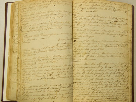 Pages from the Vanderburgh County Commissioner's Book B, dated 1819-1826, at the Evansville Civic Center Complex, Tuesday, Aug. 23, 2016. These pages note the county record of the pioneer cemetery.