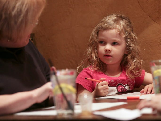 Lily Sturgis, 4, works on a coloring at the table at 317 Burger in the Broad Ripple on Feb. 22, 2014.