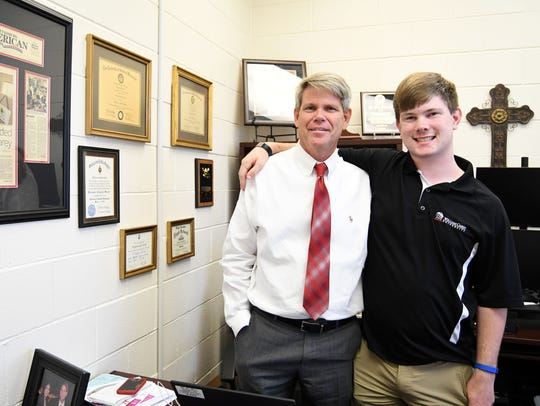 William Carey sophomore Lane Burnett stands in his father's office at the Carey School of Education, where Ben Burnett is dean.