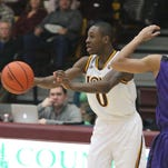 Iona's A.J. English is guarded by Niagara's Cameron Fowler during their game at Iona Jan. 4, 2016.
