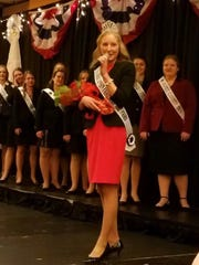 The newest Wisconsin Fairest of the Fairs, Isabella Haen of Kewaunee County, addresses the audience after being crowned during the Wisconsin Association of Fairs annual convention in Wisconsin Dells. Haen is the 52nd Fairest of the Fairs and will  represents all 76 Wisconsin county, district and state fairs during her reign.