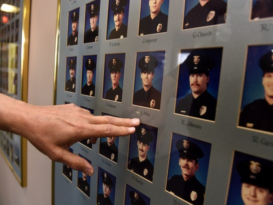 Lt. Jack Allen points to his picture from 1989 when