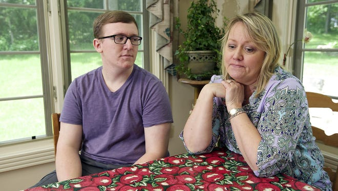 Zackery Fox, left, sits at the dining room table in his Bull Shoals home with his mother, Vickie Fox, as the family discusses the liver transplant he received in February. The liver came from an anonymous donor. Zack will be going back to Saint Louis University Hospital, where he underwent the transplant surgery four months ago, for a check-up later this month