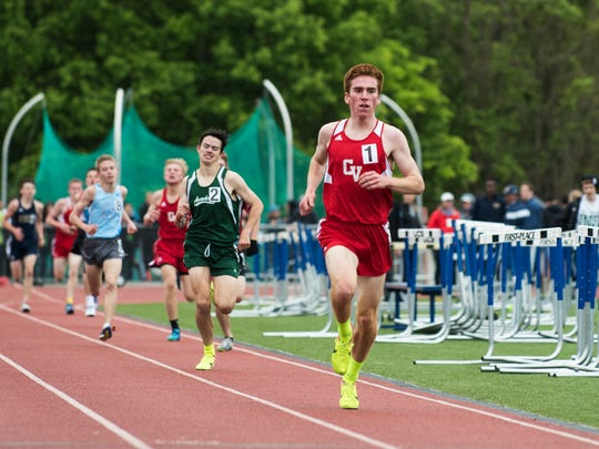 CVU's Tyler Marshall leads the pack of runners during the boys 1500m race during the division I high school track and field state championships at Burlington High School on Saturday June 3, 2017 in Burlington. (BRIAN JENKINS/for the FREE PRESS)