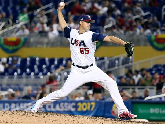 USA pitcher Nate Jones (65) throws a pitch in the ninth