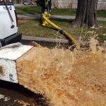Reese Saxton, a systems operator with Fort Collins Utilities, releases water from a hydrant on Whedbee Street in this file photo.