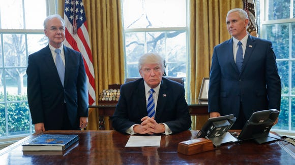 President Donald Trump, flanked by Health and Human Services Secretary Tom Price, left, and Vice President Mike Pence, right, is seen before addressing members of the media regarding the health care overhaul bill, Friday, March 24, 2017, in the Oval Office of the White House in Washington. (AP Photo/Pablo Martinez Monsivais)