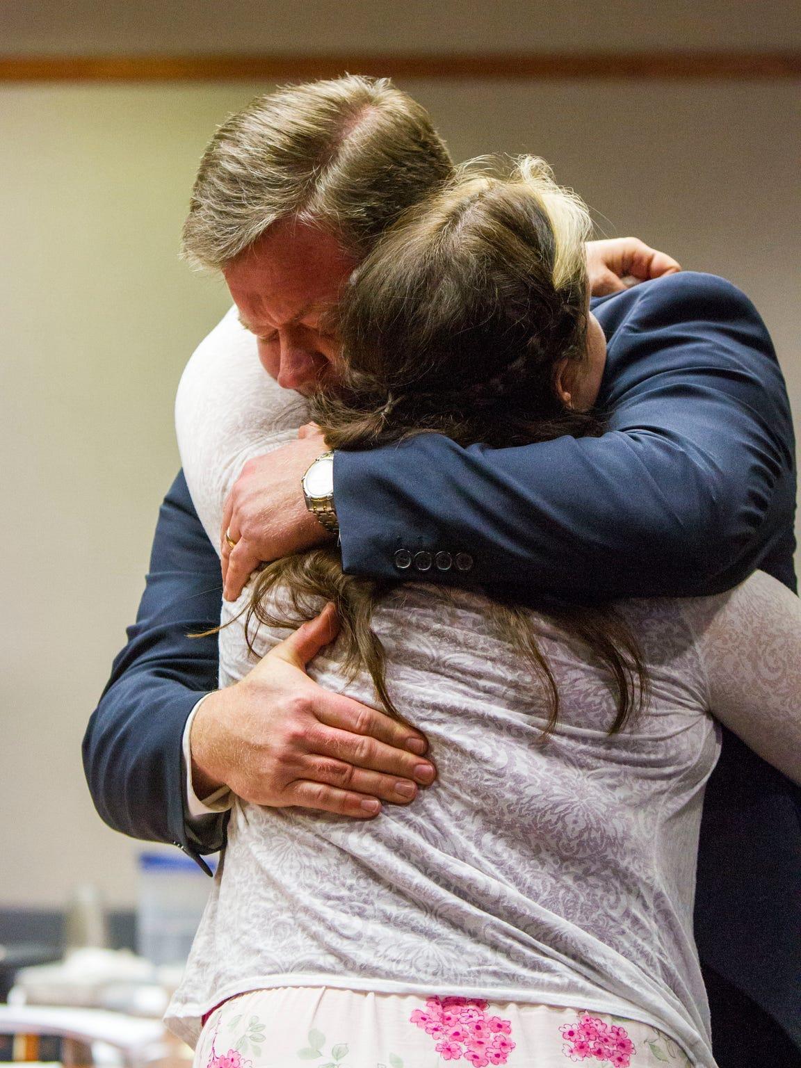 Vickie Sorensen hugs defense attorney Matthew Carling