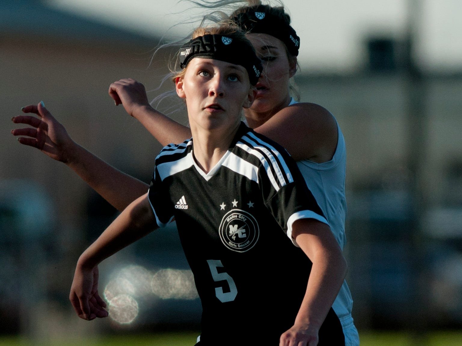 Marine City sophomore Emilie Andrews heads the ball during a soccer same Wednesday, May 13, 2015 at East China Stadium.