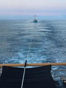 """Coast Guard cutter Sailfish tows the disabled fishing vessel """"Relentless"""" to Atlantic City on Monday."""