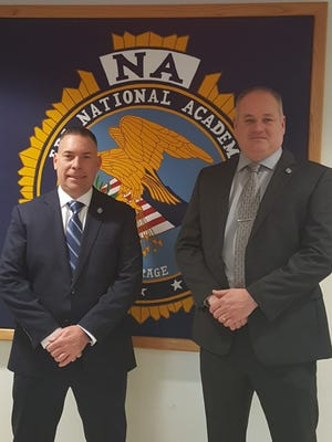 East Brunswick Police Capt. Christopher Soke (left) recently graduated from the FBI Academy. He is congratulated by East Brunswick Police Chief James Conroy.