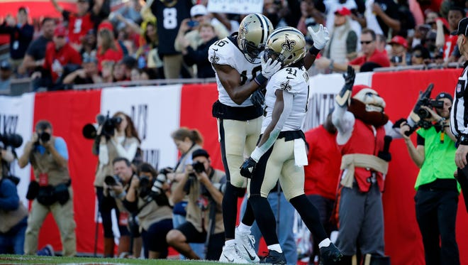 New Orleans Saints running back Alvin Kamara (41) is congratulated by wide receiver Ted Ginn (19) as he scores a touchdown during the first quarter at Raymond James Stadium.