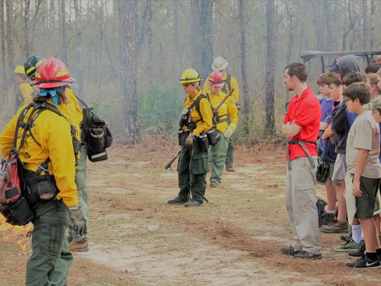 Boy Scouts watch a prescribed fire as part of the Longleaf