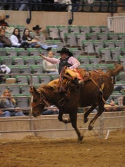 Bucking Bronco rider Shane Ortenson attempts to stay