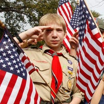 Boy Scouts ends total ban on gay leaders