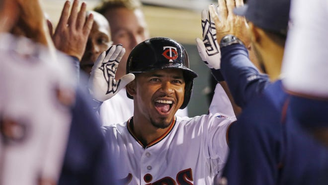 Minnesota Twins shortstop Eduardo Escobar (5) celebrates his home run against the Detroit Tigers in the fourth inning of a baseball game Monday in Minneapolis.