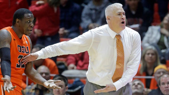 Oregon State head coach Wayne Tinkle reacts with Jarmal Reid (32) after a foul was called on Reid for tripping a referee during the second half of an NCAA college basketball game Sunday, Jan. 17, 2016, in Salt Lake City. Reid was ejected from the game. Utah won 59-53. (AP Photo/Rick Bowmer)