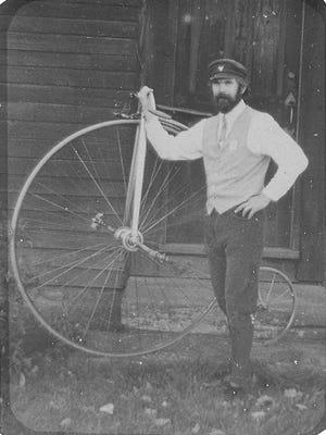 Glenn Eames of Burlington with a historic high-wheeler bicyde.