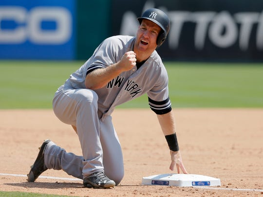 New York Yankees' Todd Frazier celebrates advancing