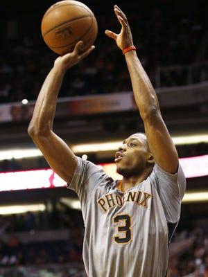 Phoenix Suns Brandon Knight shoots and makes a 3-pointer against the Oklahoma City Thunder during NBA action on Thursday, Feb. 26, 2015 in Phoenix, AZ.