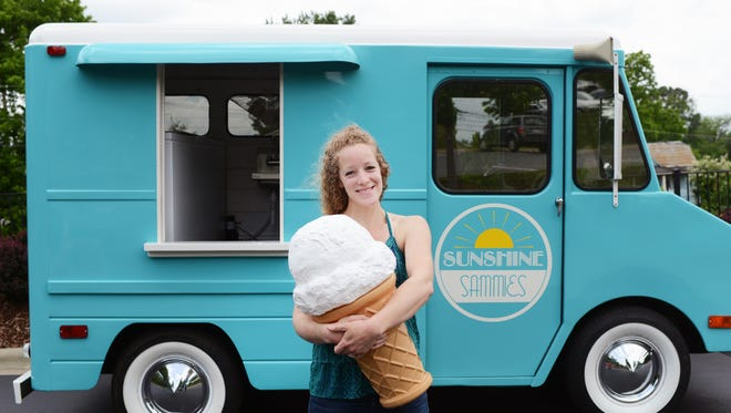 Susie Pearson, owner of Sunshine Sammies, with her food truck Sunny in 2014.