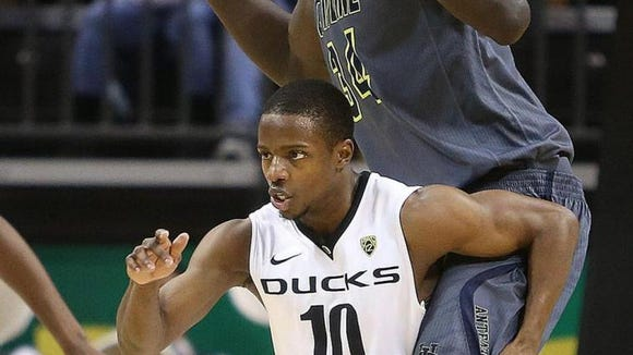 Oregon guard Johnathan Loyd, who stands 5-foot-8, tries to guard UC Irvine 7-foot-6 center Madamou Ndiaye during a recent game.