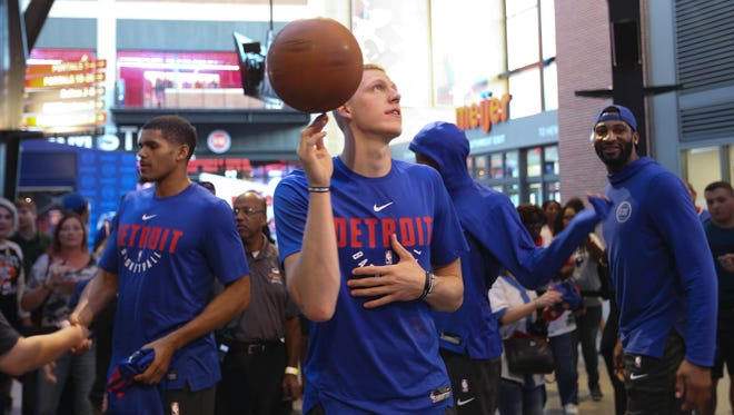 Pistons forward Henry Ellenson watches a big screen during the Meet the Team event at Little Caesars Arena on Tuesday, Oct. 3, 2017.