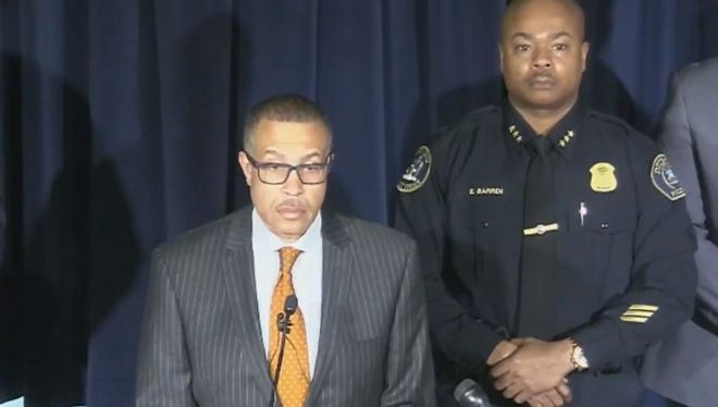 Detroit Police Chief James Craig, left, stands beside Deputy Chief Elvin Barren, right, for a press conference Wednesday.