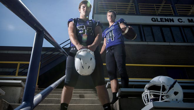 North Henderson's Cole McCarson, left, and Trevor Craft, are among five Knights who will sign to play college football on Friday.