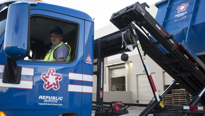 Republic Services driver Mark Chase drops off a trash dumpster container at a client in Tempe in February. Republic Services is Arizona's largest entity in terms of market capitalization.
