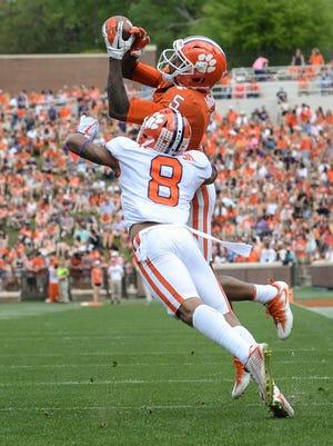 Clemson wide receiver Tee Higgins (5) catches a touchdown defensive back A.J. Terrell (8) during the 1st quarter of the spring game in Memorial Stadium in Clemson on Saturday, April 14, 2018.