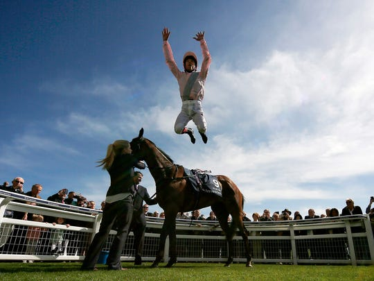 Frankie Dettori celebrates after riding So Mi Dar to win The Investec Derby Trial at Epsom racecourse in Epsom, England.