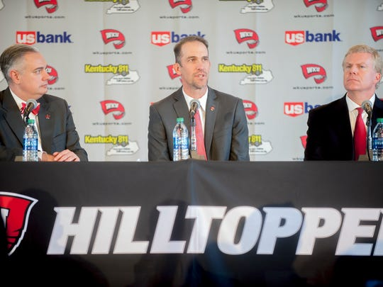 Western Kentucky's new head football coach Tyson Helton, center, speaks as WKU president Tim Caboni, left, and athletic director Todd Stewart, right,  listen during an NCAA college football press conference, Tuesday, Nov. 27, 2018, at the Jack and Jackie Harbaugh Stadium Club at Houchens-Smith Stadium in Bowling Green, Ky. (Bac Totrong/Daily News via AP)