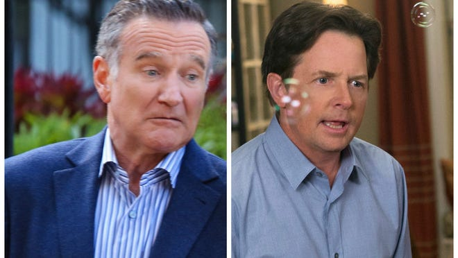 Robin Williams and Michael J. Fox did battle with competing sitcoms Thursday night.